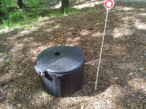 The cover to the propane tank.  We keep a marker so we can find it in the wintertime!  We lift the cover to monitor usage so we know when it needs to be refilled.