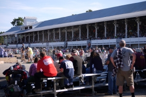 Both tiers of the grandstand are completely full, along with spectators watching on the ground.  The woodsmen's contests attract thousands of spectators.