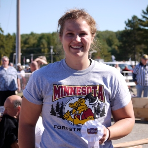 """This woman is all smiles - - she won 4th place in the young women/collegiate division.  She comes from a logging family.  """"Once wood gets into your blood, it stays,"""" she said."""
