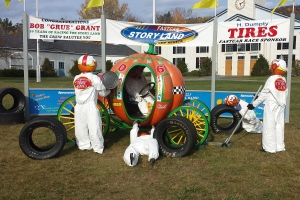 Nascar pit team readies the pumpkin carriage for the race!  Love the pumpkin tech under the carriage!