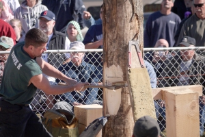 First, the contestant must chop a gash into the tree trunk that will be large enough to accommodate a slab of wood.
