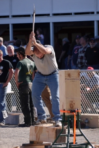 This event, called the Under Hand Chop, requires enormous hand-eye coordination!  The contestant stands on a solid wood block, and using his axe, must chop through the block between his feet with some very powerful swings without falling off the block or, G-d forbid, injuring himself in the process.  The winner chopped through the wood in less than 15 seconds.