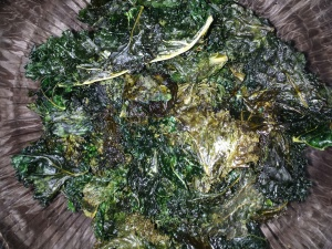 Kale chips:  separate kale leaves from stems.  Combine leaves, small amount of olive oil, salt, pepper, garlic, bit of rice vinegar, and dash of maple syrup; mix; and dry on cookie sheet in oven for several hours at 170 degrees until crispy.