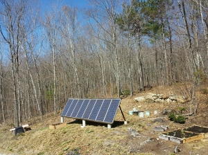 Good overview of the solar panels, composter (to left of solar panels), pots and raised bed garden.