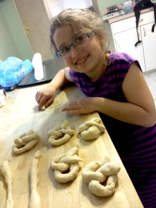 AFter the yeast dough rises, my granddaughter rolls it out and shapes the pretzels