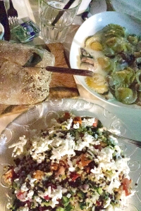 A delicious vegetarian meal of handmade spinacha and sweet potato ravioli, with a feta and goat cheese, lentil, bulghur  and edameme salad.
