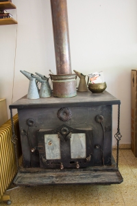 "This wood stove will burn ""gefet,"" the refuse of olives."