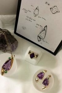 This beautiful polished and faceted amethyst jewerly was made from the larger raw stone at left