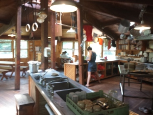 "A good overview of the main part of the hut, which shows the open kitchen and part of the dining hall.   The ""croo"" does all the cooking and organizing and ordering of supplies."