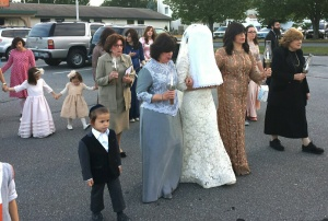 The bride is escorted to the chuppa by her mother, mother-in-law, and other close female relatives