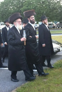 Some of the relatives of the groom who walk behind him down the aisle.  Note the fur hat, called a shtreimel, which is worn by some chassidic men.