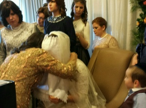The mother hugs her daughter after blessing her, following the veiling ceremony.