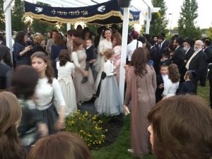 everyone rushes up to the chuppa immediately following the ceremony to offer a mazel tov.