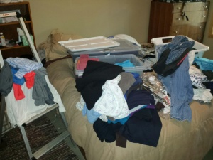 This mess is part of the closet changeover process from summer clothes to winter clothes.