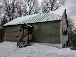 Our house.  You can see how snow has slid off part of the metal roof.