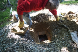 Eureka!  Dennis unburies the septic lid